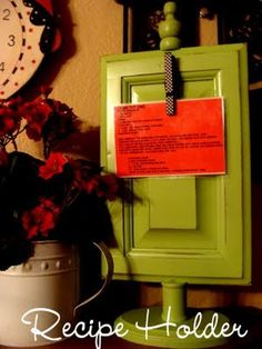 Old cabinet door turned recipe holder.  Cute.