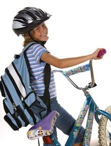 Years ago, a child riding her bicycle to school was commonplace; however the same can't be said these days. While there are pros and cons to allowing your child to ride her bike to school