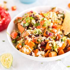Sweet Potato Burrito Bowl with spiced sweet potatoes, black beans, corn, red pepper, jalapenos and cilantro lime rice! [Vegan]