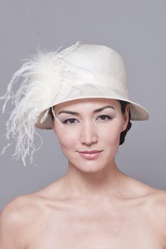 Parasisal straw cloche hat with ostrich feathers and silk taffeta lining. (to go with the Great Gatsby theme!)
