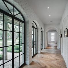 White Brick Hallway with Carriage Lanterns