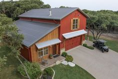 Mueller Custom Steel Building-Barn Home Living Space and Garage Description:  24x50x20 with 18x50 and 12x30 lean tos Walls:  Rustic Red;  Roof & Trim:  Burnished Slate