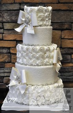 This beautiful 5 tier wedding cake is finished with pearlized buttercream rosettes and crystalized sugar. To add to the sparkle of this cake we added rhinestone bands, sugar bows and brooches. As stunning as this wedding cake is, it is also. 5 Tier Wedding Cakes, Buttercream Wedding Cake, White Wedding Cakes, Elegant Wedding Cakes, Elegant Cakes, Beautiful Wedding Cakes, Gorgeous Cakes, Wedding Cake Designs, Buttercream Fondant