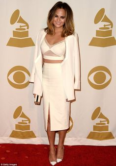 Crop star: Chrissy Teigen also appeared to take inspiration from the era in a cream bralet...