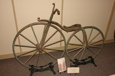 Wheeling into History Wheeling, Old Things, Chandelier, Bike, Ceiling Lights, History, Home Decor, Bicycle, Candelabra
