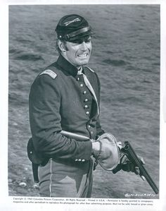 MAJOR DUNDEE (1965) - Charlton Heston with a shotgun - Directed by Sam Peckinpah - Columbia Pictures - Publicity Still.