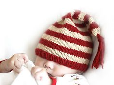 baby monstaa has stopped by the studio again, this time posing as a holiday elf! pattern and more photos below . holiday elf hat is a stripey and pointy hat, knit out of clever camel. Baby Hats Knitting, Knitting For Kids, Knitting Yarn, Knitted Hats, Knitting Patterns Free, Knit Patterns, Free Knitting, Free Pattern, Yarn Projects