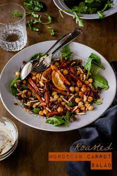 Roasted Moroccan Carrot Salad with Chickpeas Recipe - this fantastic vegetarian salad is packed full of spices and hearty and satisfying enough to feed a crowd | Get the recipe at deliciouseveryday.com