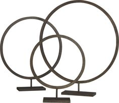 Handwrought iron round with rustic hand patina takes a geometric stance.  Choose one of three sizes, or cluster all three for maximum effect. IronHandcraftedFor indoor use onlyMade in India.