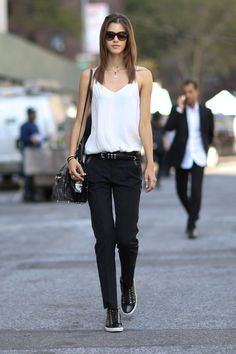 Pin for Later: The Supermodels Keep It Sleek on the Streets at PFW New York Fashion Week Trousers and a spaghetti-strap tank gets an edgy update with studded sneakers and hardware embellishments.