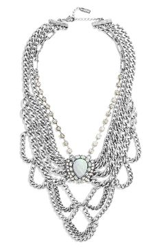 Head over heels for this stunning statement necklace: an Elizabethan-inspired silhouette evokes that glamorous era but draws on modern influence with its antiqued-silver strands and geometric shape.