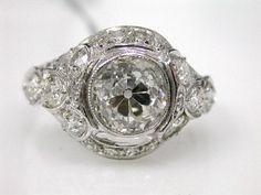 Google Image Result for http://www.cynthiafindlay.com/images/uploads/65251-65300/Art%2520deco%2520diamond%2520ring%2520CFA110456.jpg