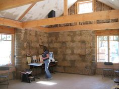"""Simple Construction"" straw bale company - post & beam construction, strawbale insulation. Only, we'd design it modern, too."