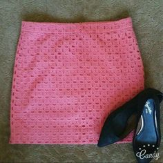 J Crew coral heavy eyelet mini skirt Super cute mini in cheery color. Mini and the thick eyelet keeps it grounded. Nice weight. Like other minis, looks cute with tall boots, pointy flats. **no rips holes stains, smoke free home** J. Crew Skirts Mini