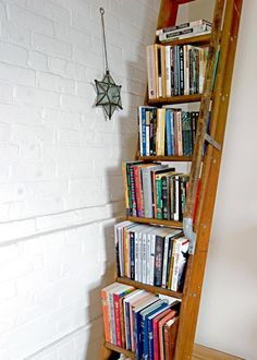 Don't throw out that old wooden ladder that's been gathering cobwebs in your garage for years — it can be re-used as an arresting book storage solution. Whether you leave it as-is as these folks did, put a sealcoat on it or paint it to match or contrast with the rest of your decor, it makes an intriguing design statement. If you decide to angle your ladder/bookcase against the wall, you might consider attaching fishing line or a wooden slat across the back above each step so the books don't…