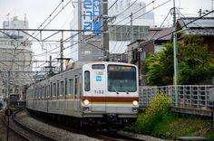 Tokyo Metro 7000 Series Train Leaving Jiyu-ga-oka Station by ykanazawa1999 on Flickr.