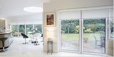 Origin Bi folding doors with Origin blinds Blinds For Bifold Doors, White Bifold Doors, Blinds For French Doors, French Door Curtains, Curtains With Blinds, Extensions, Electric Blinds, Snug Room, Living Room Windows