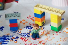 Painting with DUPLO...I've used legos for paint but never thought to build it for easier grasp! :)