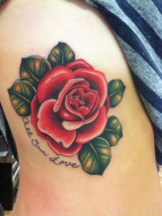 "I got this tattoo in memory of my grandmother who passed away four years ago due to brain and lung cancer. The rose represents four generations of women in my family and how amazing they are. Rose was my great grandmother's name, and it is my middle name. All through my child hood all my gifts would be themed with roses, because they made me smile. The writing ""All Our Love"" was handwritten by my grandma, in the last card she wrote me before she passed away."