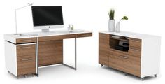 Format Collection Materials: satin finished, nickel plated steel legs with veneer and laminate finished surfaces. The Format Desk has either oak or walnut wood veneers over a core of MDF, and the version with the walnut veneer also has a white lacquered finish over MDF.