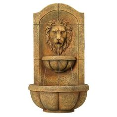 Something like this for the garden, where the previous owners had a wall mounted sculpture.  A water feature would be nice!