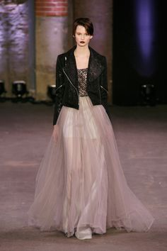 A model walks the runway at the Christian Siriano fall 2012 fashion show during Mercedes-Benz Fashion Week at the Eyebeam Atelier on February 11, 2012 in New York City.