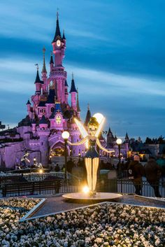 Tinkerbell statue in front of the Sleeping Beauty Castle in Disneyland Paris DLP Disney 25th anniversary