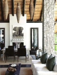 Modern space with traditional African ceiling and woven basket lamps
