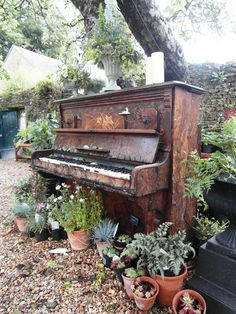What a pretty way to display an old piano- a garden center piece!