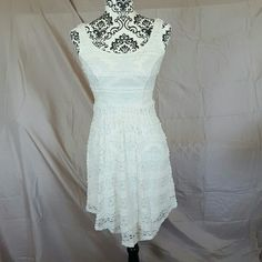 Ivory Lace Sun Dress Brand new with tags. Size X-Small. It is stretchy. Ivory lace double scoop neck. By Mossimo. Mossimo Supply Co Dresses Mini