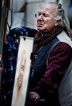 https://flic.kr/p/9Tn6aX | France - Paris: Painting Out a Living | Monmartre street painter in Paris displaying some of his portraits to potential customers.  Jon & Tina Reid  |  Travel Portfolio   |  Photography Blog   |  Travel Flickr Group