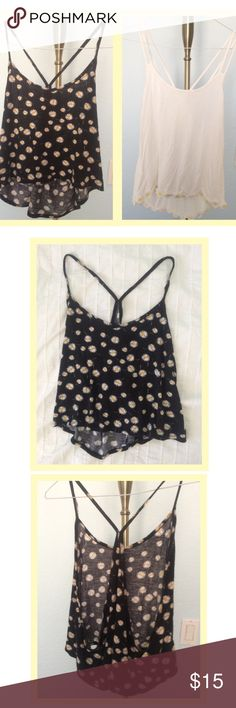 BUNDLE Sunflower & Daisy Tank Tops Both are slightly cropped and have hi-lo hems. The black one has sunflower print and the cream white one has daisies on the hem. The brand of the black one is Kirra; the brand of the other is unknown. Please make an offer! ^_^ Kirra Tops Tank Tops