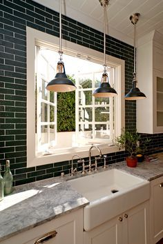 Economical black-painted brick veneer tiles in a kitchen