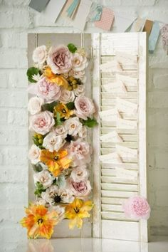 we could use our shutters painted cream and add crepe paper flowers and escort cards. Love this one!!!