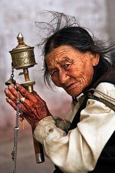"mysleepykisser-with-feelings-hid: "" Elderly Tibetan woman with a prayer wheel. """