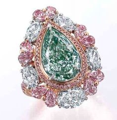 @christiesjewels Hong Kong Magnificent Jewels sale on the 29th of November brings us this amazing 5.11ct fancy green diamond surrounded by pink diamonds and white diamonds!