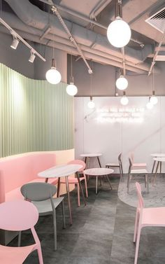 The pastel cafe is tailored to give its customers a fairytale like experience, attracting anyone who is seeking to spend some time in a light and airy atmosphere. The pastel colour scheme of pinks, greens, and neutrals perfectly compliments the marble textured murals used to give the whole space a luxurious castle feel.   This beautiful space was accomplished by using the mural marble prints from MuralsWallpaper. #wallpaper #murals #wallmurals #interior #design #homedecor #decor #accentwall Conference Room, Meeting Rooms