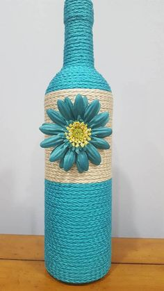 Check out this item in my Etsy shop https://www.etsy.com/listing/565528281/decorated-wine-bottle-teal-with-flower