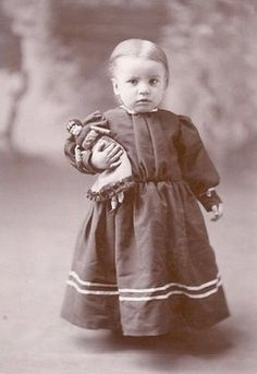 Wonderful antique photo of a sweet toddler with her doll. Circa late 19th century?