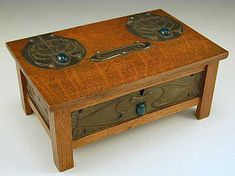 Manufacturer Unknown, Designer unknown,Oak Arts  Crafts Cigarette Box with patinated steel decorative panels adorned with green cabouchons, England, c.1910 http://www.titusomega.com/Object%20Profile%20and%20Photos/Old%20profiles/Metalware/Arts.htm