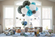 Blue and gray table display at baby shower