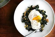 Slow-Cooked Tuscan Kale with Pancetta, Bread Crumbs, and a Poached Egg recipe: A perfect side dish for dinner—or topped with poached eggs for breakfast. Savory Breakfast, Breakfast Recipes, Breakfast Club, Brunch Recipes, Breakfast Ideas, How To Cook Kale, Fiber Rich Foods, Dinner Dishes, Brunch Dishes