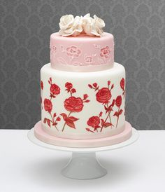 Langs of London  The eternal flower of romance, it's hard to beat roses on your wedding cake. In white, pink and red, this creation from Langs of London combines floral icing and two sugar roses on the top tier giving a chic, modern update to a traditional style.