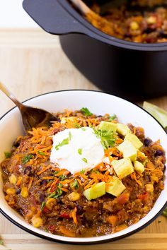 Vegan Sweet Potato and Black Bean Quinoa Chili takes only 15 minutes to prep and then right into the slow cooker! It's a hearty, thick and delicious chili!