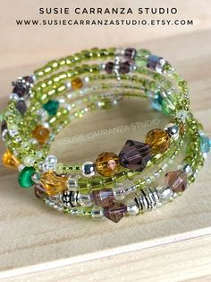 Bohemian Chic Wire Bracelet. Variety of beads in greens