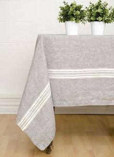 Maison Charcoal/White Linen Tablecloth 100% linen. Linen is one of the oldest fabrics known to mankind. A pure linen tablecloth is a renowned statement of classic elegance and gracious living all over