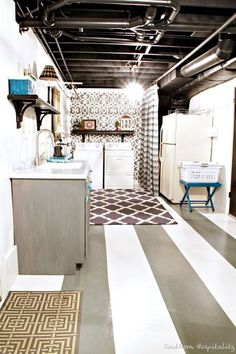 Dingy concrete floor laundry room makeover. From drab to fab!