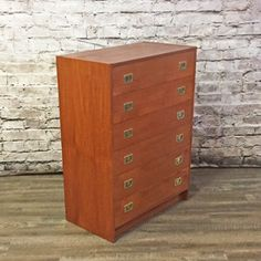 What do you think of this? Danish Mid Centur.... You can check it out here:  http://vintagehomeboutique.ca/products/danish-mid-century-teak-tall-boy-dresser-by-ervi-mobler?utm_campaign=social_autopilot&utm_source=pin&utm_medium=pin