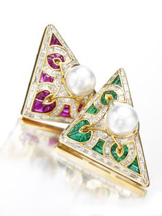 """Bulgari. A Pair of Gold, Emerald, Ruby and Diamond """"Carre"""" Brooches, by Bulgari. Available at FD.   www.fd-inspired.com"""