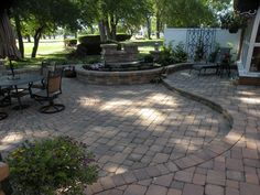 Two level stone paver patio with retaining wall and water feature. Sets the bar for outdoor living and enjoyment.